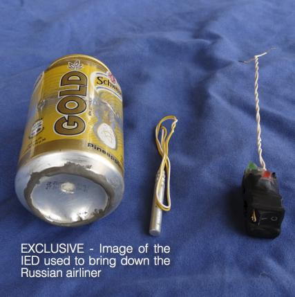 A photo published in Islamic State magazine Dabiq shows a can of Schweppes Gold soft drink and what appeared to be a detonator and switch on a blue background
